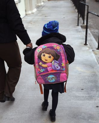 NEW YORK, NY - NOVEMBER 05: A parent and child arrive to school on November 5, 2012 in the East Village neighborhood of New York, United States. Students at Public School 188, like most schools in New York City, returned to class Monday for the first time since the hurricane hit last week. Many students in the area, which suffered severe flooding, were displaced by the storm. The school will be used as a polling center in Tuesday's Presidential election. (Photo by John Moore/Getty Images)