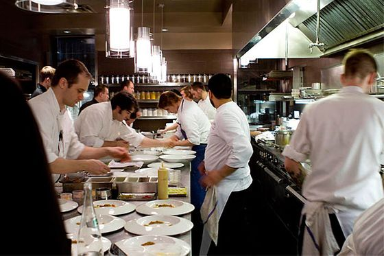 Close to two dozen chefs, an expediter, dish-washers and more are at work on a half dozen dishes at any one time.