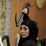 An Iranian female Ninja demonstrates her Ninjutsu skills in a martial arts club during a showcase for the media in the city of Karaj, 40 kms west of the capital Tehran, on March 15, 2012.