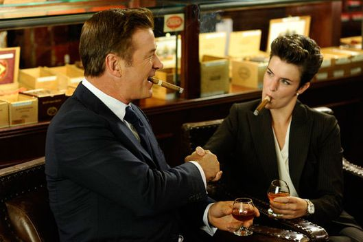 "30 ROCK -- ""Stride of Pride"" Episode 703 -- Pictured: (l-r) Alec Baldwin as Jack Donaghy, Amanda Bilger as Cigar Lady."