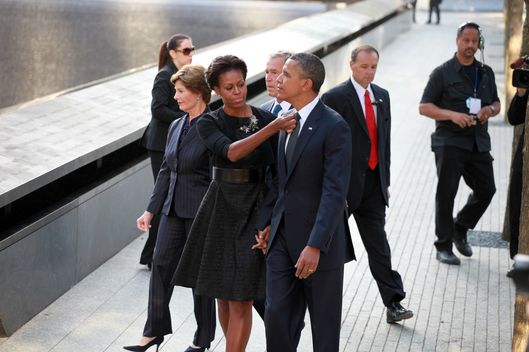 NEW YORK, NY - SEPTEMBER 11: U.S. President Barack Obama and first Lady Michelle Obama at the North Pool during the tenth anniversary ceremonies of the September 11, 2001 terrorist attacks at the World Trade Center site, September 11, 2011 in New York City. New York City and the nation are commemorating the tenth anniversary of the terrorist attacks on lower Manhattan which resulted in the deaths of 2,753 people after two hijacked planes crashed into the World Trade Center.   (Photo by Jefferson Siegel-Pool/Getty Images)