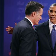 Democratic presidential candidate, U.S. President Barack Obama (R) pats Republican presidential candidate, former Massachusetts Gov. Mitt Romney on the back after the Presidential Debate at the University of Denver on October 3, 2012 in Denver, Colorado. The first of four debates for the 2012 Election, three Presidential and one Vice Presidential, is moderated by PBS's Jim Lehrer and focuses on domestic issues: the economy, health care, and the role of government.