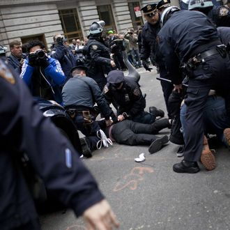 NEW YORK, NY - NOVEMBER 17: Police officers arrest protesters affiliated with the Occupy Wall Street movement at the intersection of Exchange Place and Beaver Street in the Financial District on November 17, 2011 in New York City. Protesters attempted to shut down the New York Stock Exchange today, blocking roads and tying up traffic in Lower Manhattan. (Photo by Andrew Burton/Getty Images)