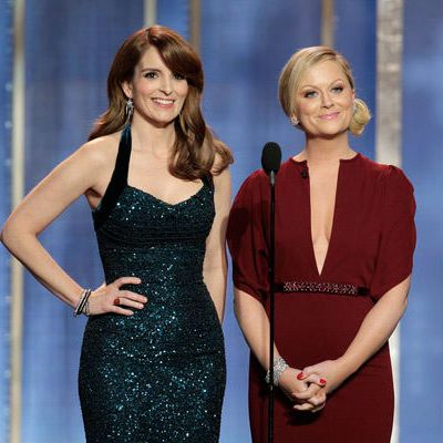 70th ANNUAL GOLDEN GLOBE AWARDS -- Pictured: (l-r) Tina Fey, Amy Poehler, hosts on stage during the 70th Annual Golden Globe Awards held at the Beverly Hilton Hotel on January 13, 2013.