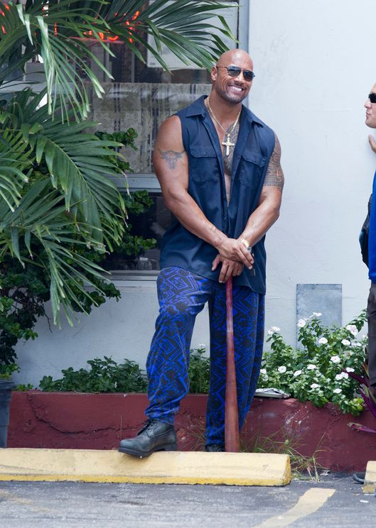 "The Rock, Dwayne Johnson, shows off his baseball swing filming scenes for the movie ""Pain and Gain"" with Mark Wahlberg in Miami."