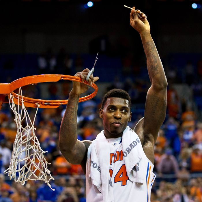 Casey Prather #24 of the Florida Gators holds up a piece of the net after the game against the Kentucky Wildcats at the Stephen C. O'Connell Center on March 8, 2014 in Gainesville, Florida. The Gators were 18-0 in the SEC Conference and undefeated at home this season.