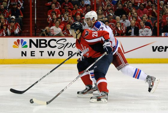 WASHINGTON, DC - MAY 02:  Alexander Semin #28 of the Washington Capitals and Ryan McDonagh #27 of the New York Rangers battle for the puck in Game Three of the Eastern Conference Semifinals during the 2012 NHL Stanley Cup Playoffs at the Verizon Center on May 2, 2012 in Washington, DC.  (Photo by Patrick McDermott/Getty Images)