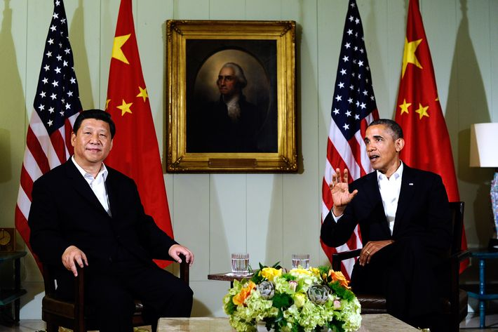 "US President Barack Obama (R) answers a question as Chinese President Xi Jinping listens following their bilateral meeting at the Annenberg Retreat at Sunnylands in Rancho Mirage, California, on June 7, 2013.Obama, with Chinese counterpart Xi Jinping by his side, called Friday for common rules on cybersecurity after allegations of hacking by Beijing. At a summit in the Calfornia desert, Obama said it was ""critical"" to reach a ""permanent understanding"" on cybersecurity. He also voiced concern over intellectual theft and urged ""common rules of the road."" AFP PHOTO/Jewel Samad        (Photo credit should read JEWEL SAMAD/AFP/Getty Images)"