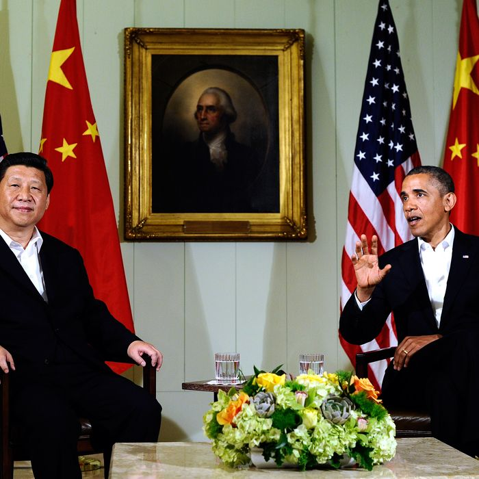 US President Barack Obama (R) answers a question as Chinese President Xi Jinping listens following their bilateral meeting at the Annenberg Retreat at Sunnylands in Rancho Mirage, California, on June 7, 2013.Obama, with Chinese counterpart Xi Jinping by his side, called Friday for common rules on cybersecurity after allegations of hacking by Beijing. At a summit in the Calfornia desert, Obama said it was