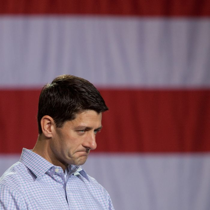 MOORESVILLE, NC - AUGUST 12: Republican vice presidential candidate, U.S. Rep. Paul Ryan (R-WI) listens as his running mate, Republican presidential candidate and former Massachusetts Governor Mitt Romney speaks during the Mooresville Victory Rally August 12, 2012 at NASCAR Technical Institute in Mooresville, North Carolina. Mitt Romney will make stops in Florida and Ohio during his four-day bus tour. (Photo by John Adkisson/Getty Images)