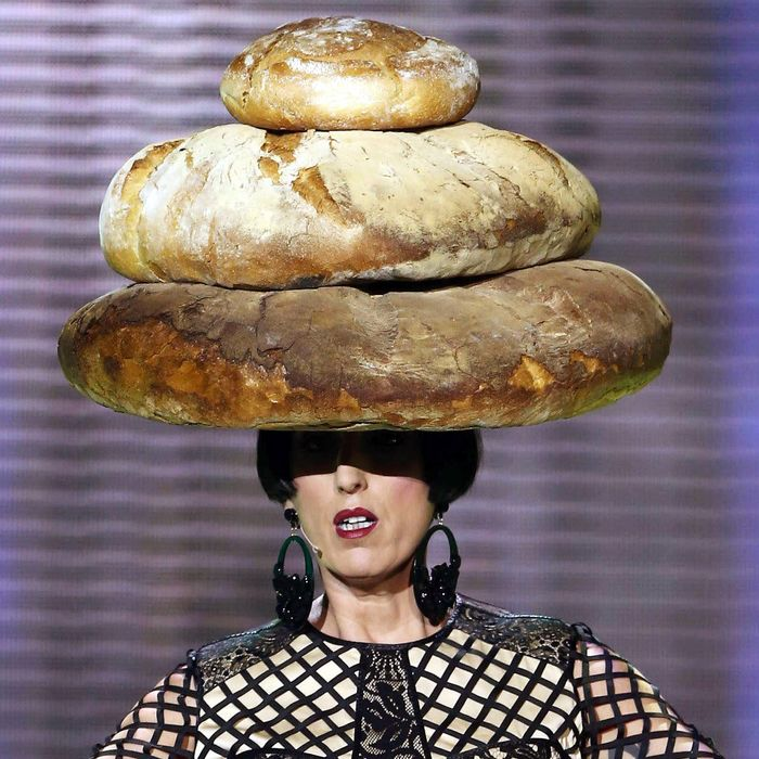 Rossy de Palma in a bread hat.