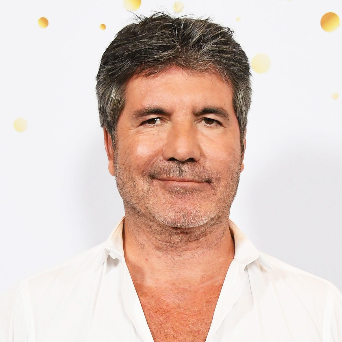 Simon Cowell Hospitalized With Broken Back After Bike Fall