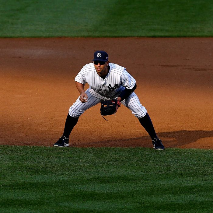 NEW YORK, NY - OCTOBER 14: Alex Rodriguez #13 of the New York Yankees readies on defense at third base against the Detroit Tigers during Game Two of the American League Championship Series at Yankee Stadium on October 14, 2012 in the Bronx borough of New York City. (Photo by Al Bello/Getty Images) *** Local Caption *** Alex Rodriguez