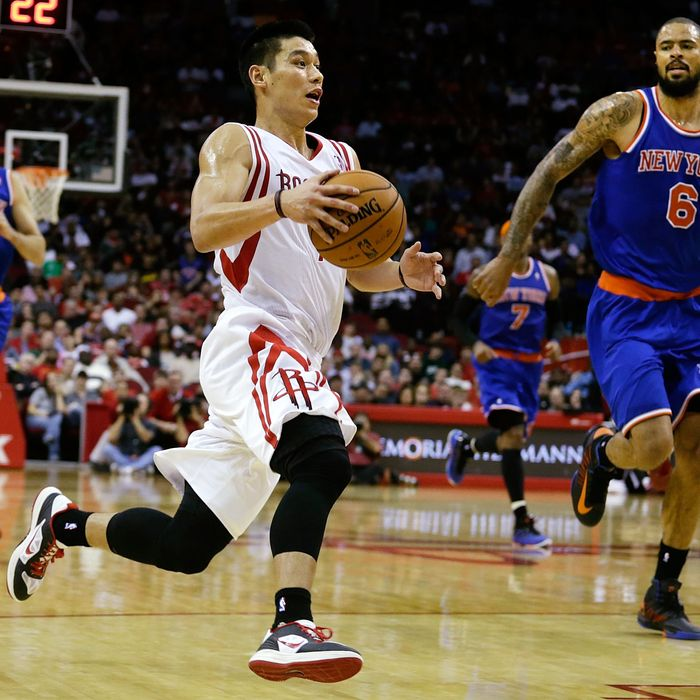 Jeremy Lin #7 of the Houston Rockets drives upcourt past Tyson Chandler #6 the New York Knicks at the Toyota Center on November 23, 2012 in Houston, Texas.