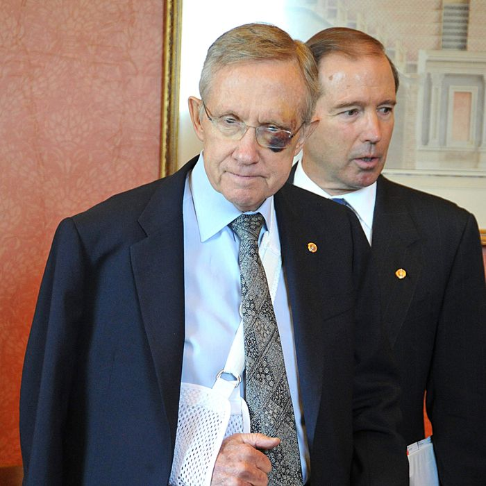 Senate Majority Leader Harry Reid , D-NV, recovering from a fall during a morning run last week, arrives with Sen. Tom Udall D-NM for a meeting with Mexico's Felipe Calderon at the US Capitol on May 11, 2011 in Washington, DC. Calderon will meet with senators Reid, Mitch McConnell, R-KY, Diane Feinstein ,D-CA, and other Congressional leaders to discuss US/Mexico relations. AFP PHOTO/Karen BLEIER (Photo credit should read KAREN BLEIER/AFP/Getty Images)