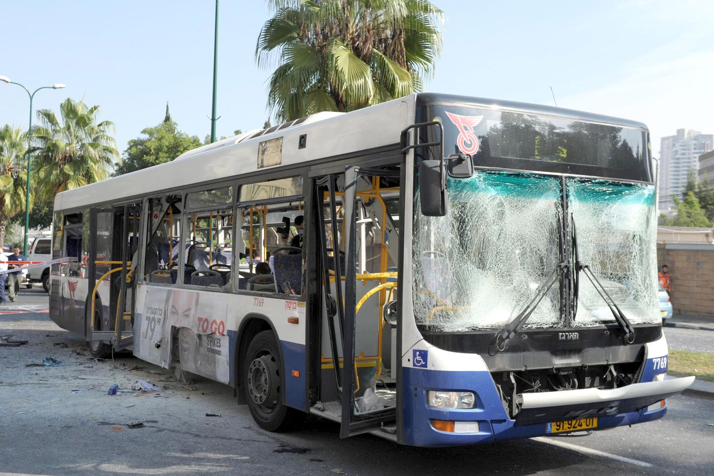 A general view of the scene after a bus exploded with passengers onboard on November 21, 2012 in central Tel Aviv, Israel. At least ten people have been injured in a blast on a bus near military headquarters in what is being described as terrorist attack which threatens to derail ongoing cease-fire negotiations between Israeli and Palestinian authorities.