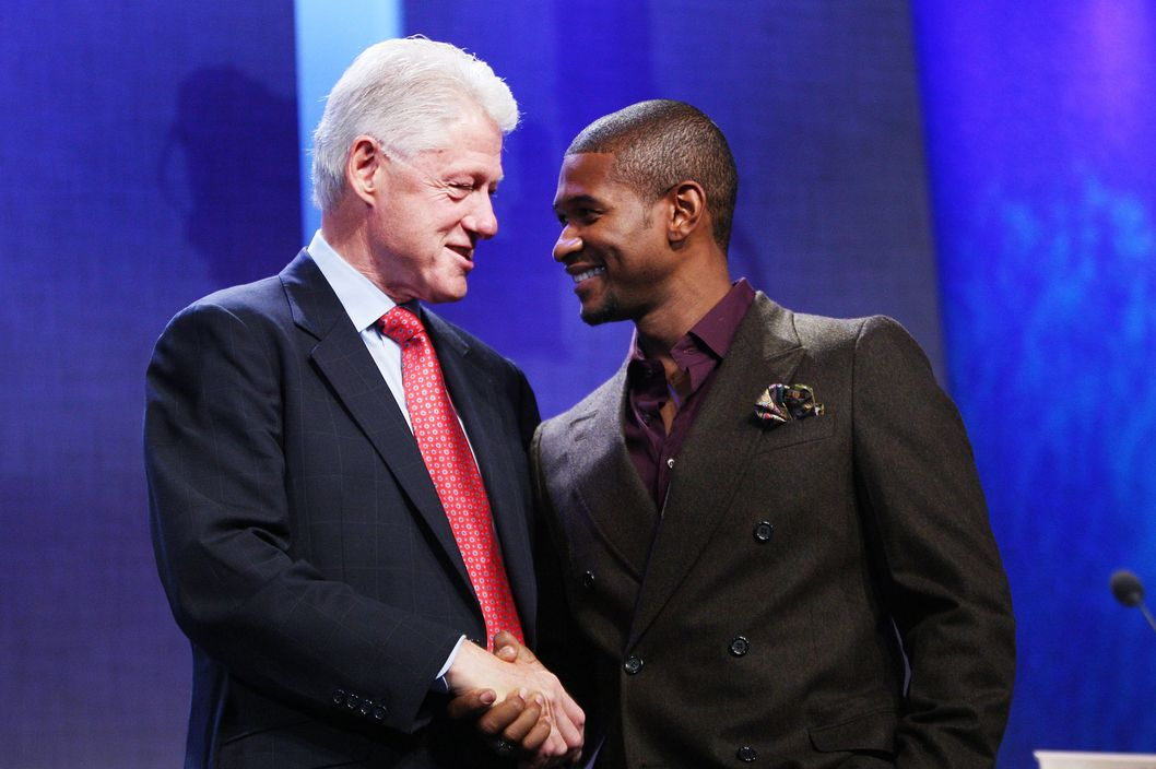 Former President Bill Clinton (L) and singer Usher appear at the Clinton Global Initiative (CGI) on September 24, 2009 in New York City. The Fifth Annual Meeting of the Clinton Global Initiative (CGI) looks to gather prominent individuals in politics, business, science, academics and religion to discuss global issues such as climate change and peace in the Middle East. The event, founded by former president Bill Clinton after he left office, is held the same week as the General Assembly at the United Nations as most world leaders are in New York.