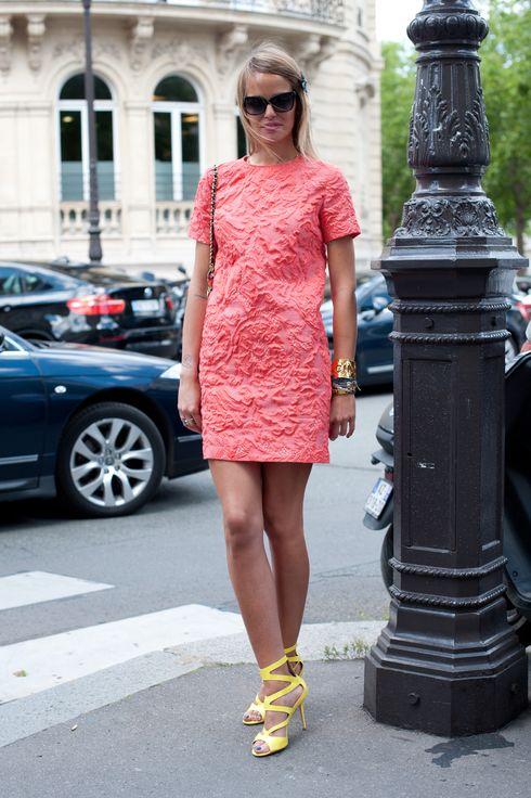 Carlotta Oddi assistant to Anna Dello Russo at Vogue Japan wearing Jimmy Choo shoes, chanel bag, vintage chanel bracelet, MSGN dress and Olivier Goldsmith sunglases at Paris Fashion Week Autumn/Winter 2012 haute couture shows on July 02, 2012 in Paris, FRANCE.