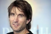 """South African actor Sharlto Copley poses during the photocall of the movie """"District 9"""" directed by South African born director Neill Blomkamp on September 6, 2009 at the 35th American Film Festival, in Deauville, northwestern France.           AFP PHOTO / FRANCOIS GUILLOT (Photo credit should read FRANCOIS GUILLOT/AFP/Getty Images)"""