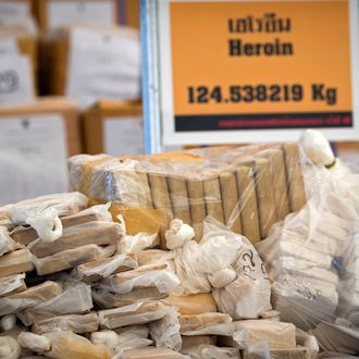 Bags of heroin seized by the Thai narcotic police department are seen on display before being incinerated in Ayutthaya on September 17, 2011. Yingluck Shinawatra has announced the government will begin an urgent anti-drugs campaign. AFP PHOTO / Nicolas ASFOURI (Photo credit should read NICOLAS ASFOURI/AFP/Getty Images)