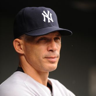 BALTIMORE, MD - AUGUST 28: Manager Joe Girardi #28 of the New York Yankees looks on during a baseball game against the Baltimore Orioles at Oriole Park at Camden Yards on August 28, 2011 in Baltimore, Maryland. (Photo by Mitchell Layton/Getty Images)