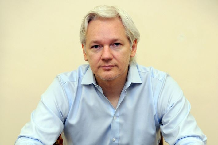 "Wikileaks founder Julian Assange speaks to the media inside the Ecuadorian Embassy in London on June 14, 2013, ahead of the first anniversary of his arrival there on June 19, 2012. A year after seeking refuge at the Ecuadorian embassy in London, Julian Assange remains fearful of US ""revenge"" over the WikiLeaks disclosures and aware that the diplomatic deadlock over his case may continue for months, if not years."