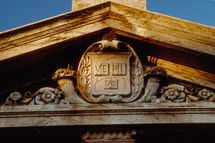 1986, Cambridge, Massachusetts, USA --- Pediment of a gate to Harvard University --- Image by ? Todd Gipstein/CORBIS