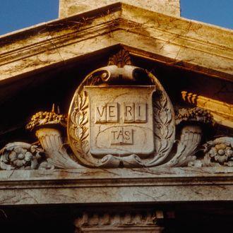 1986, Cambridge, Massachusetts, USA --- Pediment of a gate to Harvard University --- Image by ? Todd Gipstein/CORBIS