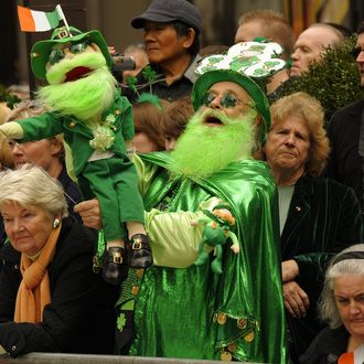 Parade-goers watch the 251st St Patrick's Day Parade up 5th Avenue in New York on March 17, 2012. AFP PHOTO / TIMOTHY A. CLARY (Photo credit should read TIMOTHY A. CLARY/AFP/Getty Images)