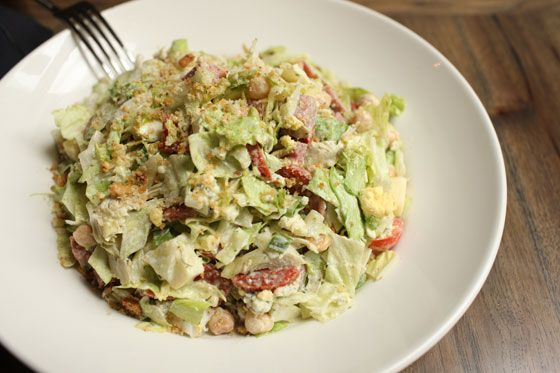With iceberg lettuce, tomato, garbanzo beans, artichoke hearts, salami, pepperoni, boiled egg, and sweet basil dressing<br>