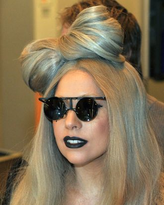 US pop singer Lady Gaga arrives at Narita International Airport, suburdan Tokyo on December 20, 2011. The pop star will attend a Japanese television's music program. AFP PHOTO / KAZUHIRO NOGI (Photo credit should read KAZUHIRO NOGI/AFP/Getty Images)