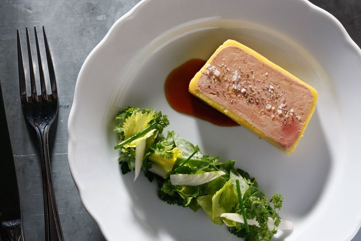 Foie gras terrine with herb salad, apple vinegar, and brioche.
