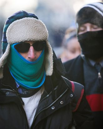 NEW YORK, NY - JANUARY 07: A man bundles up against the cold on the morning of January 7, 2014 in New York, United States. A polar vortex has descended on much of North America, coming down from the Arctic, bringing record freezing temperatures across much of the country. (Photo by Andrew Burton/Getty Images)