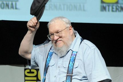 "Writer George R.R. Martin speaks onstage during the ""Game Of Thrones"" panel during Comic-Con International 2013 at San Diego Convention Center on July 19, 2013 in San Diego, California."