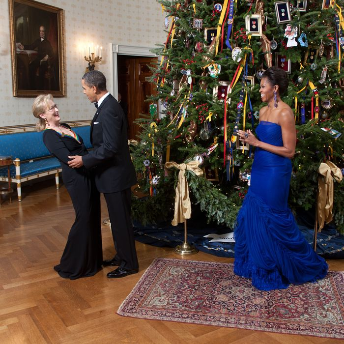 President Barack Obama and First Lady Michelle Obama greet Kennedy Center Honoree Meryl Streep in the Blue Room of the White House, Dec. 4, 2011.