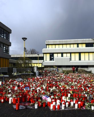A man mourns by a memorial of flowers and candles in front of the Joseph-Koenig-Gymnasium secondary school in Haltern am See, western Germany on April 1, 2015, from where some of the Germanwings plane crash victims came. A church service will take place in the small western German town of Haltern to remember 16 pupils and two teachers from the same school who were killed in the Germanwings air disaster as they returned from an exchange trip to Barcelona. AFP PHOTO / SASCHA SCHUERMANN (Photo credit should read SASCHA SCHUERMANN/AFP/Getty Images)