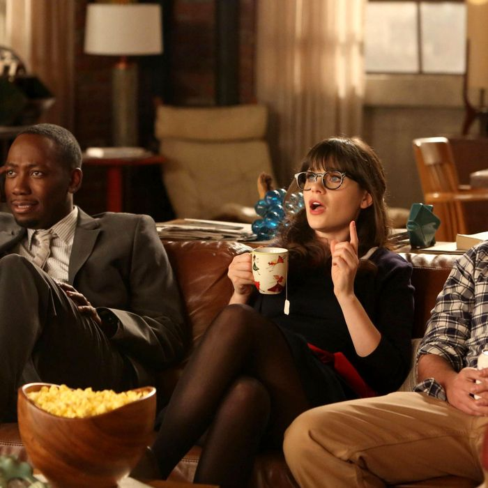NEW GIRL: L-R: Winston (Lamorne Morris), Jess (Zooey Deschanel) and Nick (Jake Johnson) listen as Schmidt tells them of his plans for their big party celebrating Nick and Schmidt's tenth anniversary of living together in the