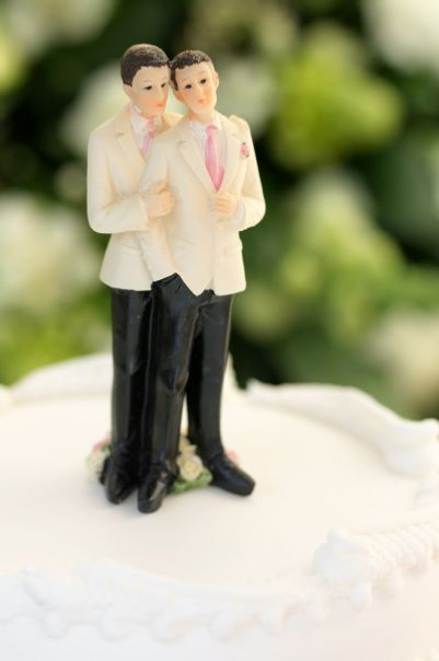 Figurines, depicting a gay wedding or Civil Partnership, on top of a wedding cake, narrow focus on the head.