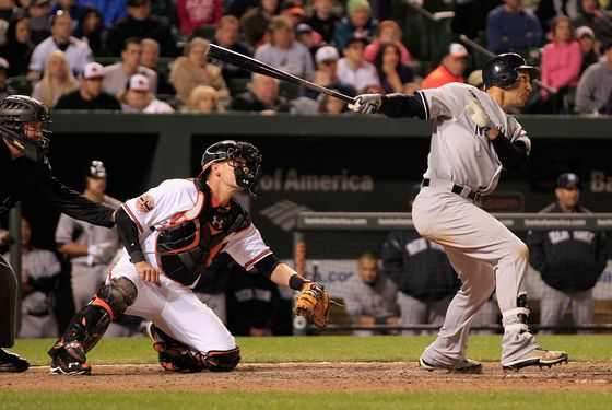 BALTIMORE, MD - APRIL 10: Raul Ibanez #27 of the New York Yankees follows his game winning RBI double as catcher Matt Wieters #32 of the Baltimore Orioles looks on during the 12th inning at Oriole Park at Camden Yards on April 10, 2012 in Baltimore, Maryland. The Yankess won 5-4.  (Photo by Rob Carr/Getty Images)