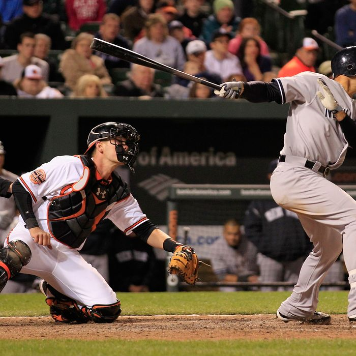 Raul Ibanez #27 of the New York Yankees follows his game winning RBI double
