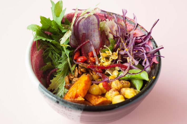 Dragon bowl with coconut grains, vegetables, garbanzo, and beet tahini.