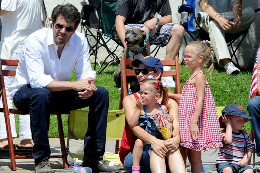 Ben Affleck kisses wife Jennifer Garner at 4th July parade in Los Angeles, Ca. The actors took both daughters Violet and Seraphina to the parade in the pacific palisades area of Los Angeles. Jennifer was seen waving to the floats and parade as she showed off her american pride buying flags for her two children. Violet even showed her patriotism by singing during the national anthem. They watched the parade for over an hour and Ben even Kissed Jen's hand during the festivities.
