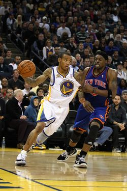 OAKLAND, CA - DECEMBER 28:  Monta Ellis #8 of the Golden State Warriors drives on Bill Walker #5 of the New York Knicks at Oracle Arena on December 28, 2011 in Oakland, California.  NOTE TO USER: User expressly acknowledges and agrees that, by downloading and or using this photograph, User is consenting to the terms and conditions of the Getty Images License Agreement.  (Photo by Ezra Shaw/Getty Images)