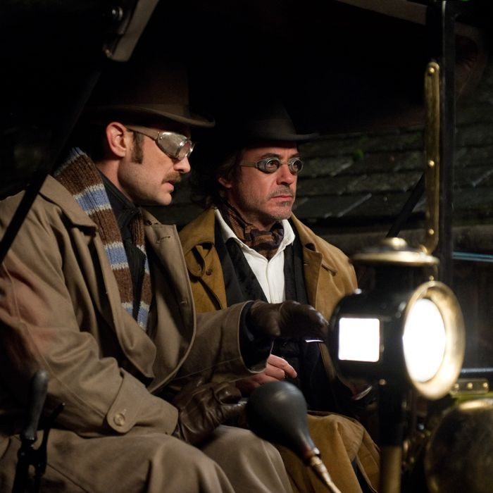 """(L-r) JUDE LAW as Dr. James Watson and ROBERT DOWNEY JR. as Sherlock Holmes in Warner Bros. Pictures' and Village Roadshow Pictures' action adventure mystery """"SHERLOCK HOLMES: A GAME OF SHADOWS,"""" a Warner Bros. Pictures release."""