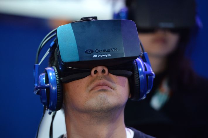 An attendee wears an Oculus Rift HD virtual reality head-mounted display at he plays EVE: Valkyrie, a multiplayer virtual reality dogfighting shooter game, at the Intel booth at the 2014 International CES, January 9, 2014 in Las Vegas, Nevada.
