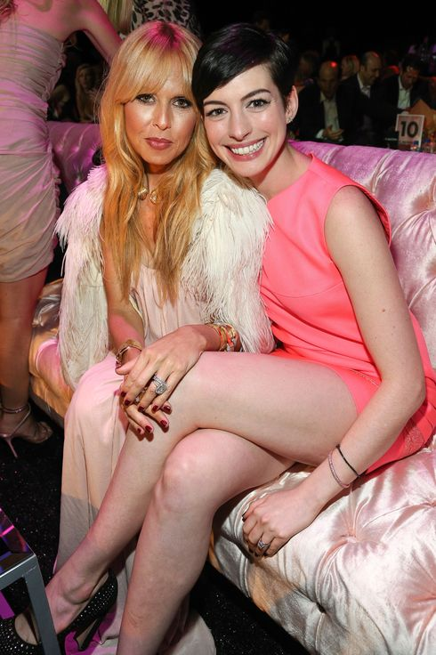 Designer Rachel Zoe (L) and actress Anne Hathaway attend FIJI Water at the 9th Annual Pink Party Benefiting The Cedars-Sinai Women's Cancer Program at HANGAR:8 on October 19, 2013 in Santa Monica, California.