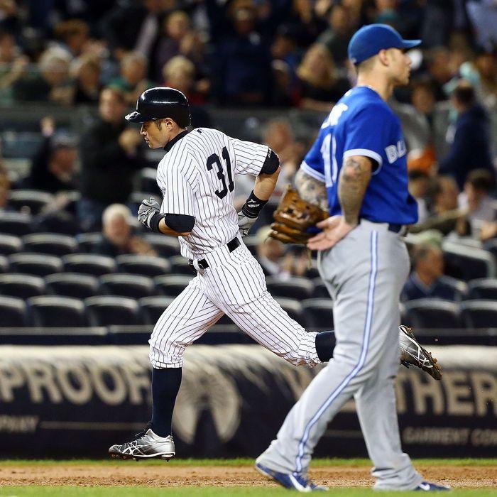 Ichiro Suzuki #31 of the New York Yankees runs the bases after his third inning home run past Brett Lawrie #13 of the Toronto Blue Jays at Yankee Stadium on September 20, 2012 in the Bronx borough of New York City