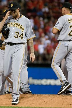 ST. LOUIS, MO - MAY 2: A.J. Burnett #34 of the Pittsburgh Pirates walks off the mound after giving up 12 runs on 12 hits in 2.2 innings of work against the St. Louis Cardinals at Busch Stadium on May 2, 2012 in St. Louis, Missouri.  (Photo by Jeff Curry/Getty Images)