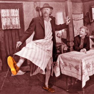 Jack Albertson dancing and Peter Ostrum watching him in a scene from the film 'Willie Wonka And The Chocolate Factory', 1971.