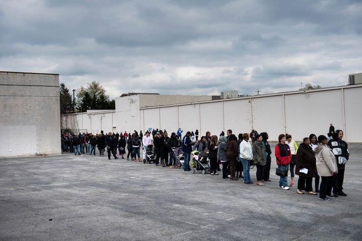 People wait in line for early voting in the parking lot of the Northland Park Center on November 4, 2012 in Columbus, Ohio. Ohio, a battleground state, is closely contested between US President Barack Obama and Mitt Romney. No Republican has won the US presidency without winning Ohio's electoral votes.